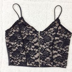 Faux leather crop top Brand Tic Toc Size: M New Colors: Black and Beige  Faux leather  Floral/lace  Straps are not adjustable  Front zipper for closure  Spaghetti straps  No Trade Tops Crop Tops