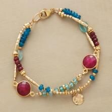 This lively handmade ruby and apatite bracelet shimmers with irrepressible charm.