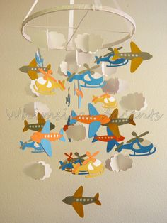 On the Go Baby Paper Mobile with Airplanes, Helicopters and Clouds. $75.00, via Etsy.