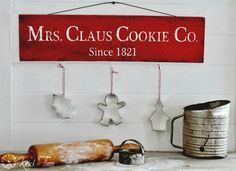 Rustic Christmas Sign embellished with cookie cutters by Knick of Time. #12days72ideas