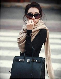 simple black shirts are a must. accessorized right, like here with a long scarf, oversize sunglasses and the perfect bag can make it a stylish and classy outfit for a girls night out, a date or a shopping spree, dress it down with a pair of jeans and running shoes and you've got a great errand running outfit