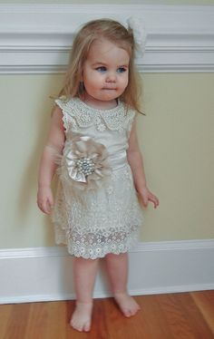This will be Peyton's flower girl dress.    Vintage Shabby Chic Style Ivory Lace Flower by chelseasbowtique, $60.00