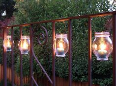 Hang Mason jars with tea candles inside for a great DIY outdoor lighting idea!