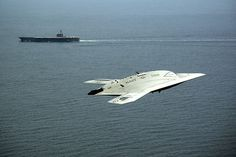 ATLANTIC OCEAN (May 14, 2013) An X-47B Unmanned Combat Air System (UCAS) demonstrator flies near the aircraft carrier USS George H.W. Bush (CVN 77). George H.W. Bush is the first aircraft carrier to successfully catapult launch an unmanned aircraft from its flight deck. (U.S. Navy photo by Erik Hildebrandt/Released)