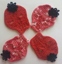 Crocheted sugar skull coasters. www.etsy.com/shop/DuchessofCrochet