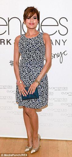 40-year-old Eva Mendes promoting her vintage-inspired fashion line...
