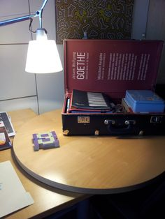 """Ready for Frankfurt Bookfair - the business suitcase is ready for transportation (on the desk the melted """"Timecube"""" for 2012 from René Knip, published from Herman Schmidt Verlag Mainz)"""