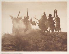 Dancing to Restore an Eclipsed Moon - Qagychly (c) 1907-1930 by Edward S Curtis...one of the best photographers EVER.