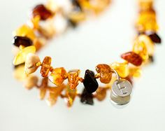 Check out Personalized Baby teething necklace from mixed colour Baltic amber on dropofamber