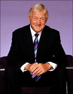Michael Parkinson. I mute the sound when his wretched insurance ad comes on the TV.