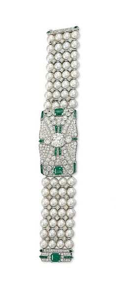 AN ART DECO EMERALD, CULTURED PEARL AND DIAMOND BRACELET   Composed of an articulated geometric design panel, centred by an old-cut cushion shaped diamond within a pavé circular-cut diamond surround, with square and calibré-cut emerald accents, to the four-row cultured pearl and diamond point bracelet and similarly-set emerald and diamond clasp, circa 1930, 17.9cm long, emerald probably a later addition