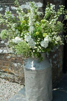 Flowers in a milk churn--lovely The Garden Gate Flower Company Wedding Flower Arrangements, Floral Arrangements, Wedding Flowers, Winter Flowers, Green Flowers, Green Bouquets, Flowers Garden, Diy Flowers, Amazing Flowers