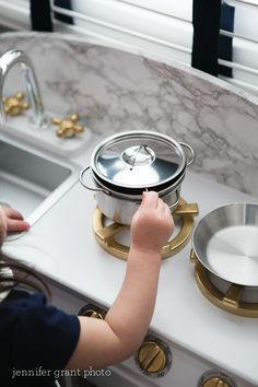 "Playroom DIY - spray paint the fixtures on your kitchen set for an adorable upgrade. Love these ""brass"" fixtures on this @kidkraft kitchen play set!"
