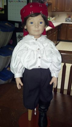 """Excellent condition Approximately 28"""" tall, stands Cloth body and porcelain head, lower arms/hands, left lower legs/foot, upper right leg...peg leg at lower portion and a porcelain breast/back plate He is marked on the back of his head: Ollie Polly, by RuBert © 1994, The Doll Artworks, Inc. He has a hand painted face and beautiful blue eyes with false eyelashes on top lid His left ear is pierced but he his not wearing an earring He has dark brown hair and his head swivels He is dressed in a…"""