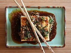 Warm tofu with spicy garlic sauce: 10 minutes! Steam tofu over med low heat. For sauce, mix:      1 teaspoon chopped garlic      1/4 cup chopped scallion      2 teaspoons sesame seeds, toasted and crushed with side of a heavy knife      3 tablespoons soy sauce      1 tablespoon Asian sesame oil      1 teaspoon coarse Korean hot red-pepper flakes      1/2 teaspoon sugar  Serve Warm