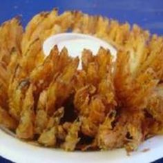 Baked Onion Blossom Recipe | Just A Pinch Recipes Vegetable Appetizers, Vegetable Recipes, I Love Food, Good Food, Yummy Food, Tasty, Onion Blossom Recipe, Baked Blooming Onion, Baked Onions