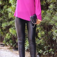 Liquid shiny black leggings These stretchy pants gather along the bottom of each side. They are rouched. I have several pairs of these pants which were worn once by a go go team. I wear mine often and showcase them in several cover shots as shown. Pants Leggings