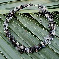 Evoking a floral garland in shadows, Nareerat creates a beautiful necklace. Labradorite's subtle tones mingle with smoky quartz, onyx and pearls in black and gray.   69.95