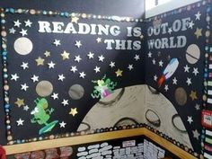 """I love how this teacher designed a corner reading bulletin board display using a space theme and the title: """"Reading Is Out Of This World!"""""""