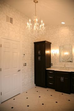 Transitional design and classic touches create an elegance in a master bath.