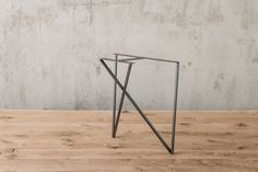 Our inside out table leg possesses great balance between elegance and raw industrial style.  made of solid square bar and clear powder coating this