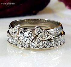 Double triskele love knot with matching channel set diamond wedding ring