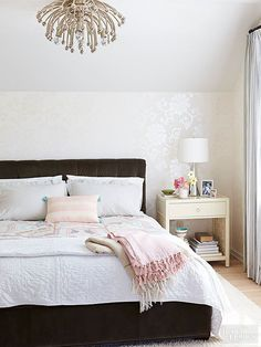 Give your bedroom a tasteful dose of glam with a slightly shimmery wallpaper and clean neutral colors.