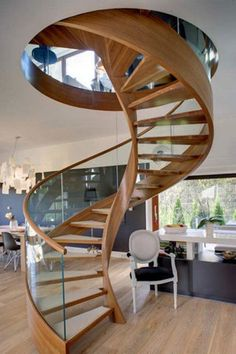 winding timber staircase with glass balustrade