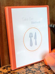 Take out menu binder with plastic sleeves in kitchen is a must! No more loose papers in a drawer!