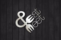 #Silver and #black Eat Meet logo with fork