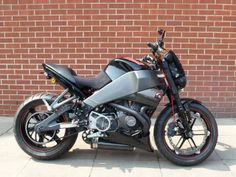 2007 XB12S Lightning Buell heavily modified by Warr's Kings Rd dealership. Features carbon bodywork, bespoke chassis and trim, custom paint. Built for D. Knight June 2007.  Raging Buell