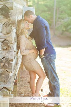 Nice image of a pregnant couple in love.  Love the emotion.