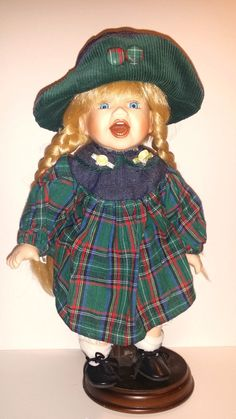 Up for sale is a Vintage Porcelain Dressed Collectible Girl Doll Blonde Hair Unbranded 13 Tall. Vintage wear and tear present. This doll is