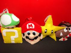 http://www.etsy.com/listing/78356733/felt-ornaments-mario-bros-4-pc