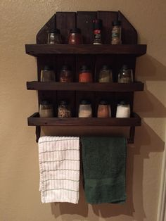 Pallet wood spice/towel rack! This was my very first wood project and I made it completely out of old pallet wood that I was able to pick up for free.