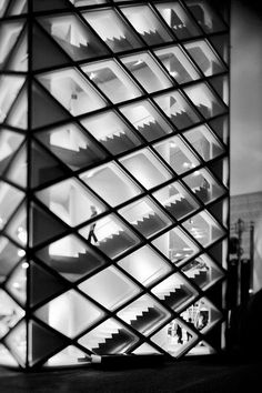 "Minato-ku, Tokyo, Japan [Prada's Tokyo store]  by Herzog & de Meuron /  The Tokyo store is a strikingly unconventional 6-story glass crystal that is soft despite its sharp angles – as a result of its five-sided shape, the smooth curves throughout its interior, and its signature diamond-shaped glass panes, which vary between flat, concave and convex ""bubbles""."