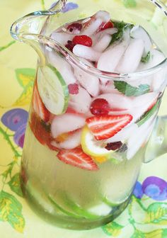 Fruit Water      1 each of the following fruits: apple, lemon, orange, pear      4 large strawberries      Handful of raspberries      Handful of mint leaves      1 half-gallon of water      Cut large slices or thin wedges of each fruit, place them in a large glass pitcher       and add cold water. Refrigerate 2 hours and serve over ice in tall glasses.