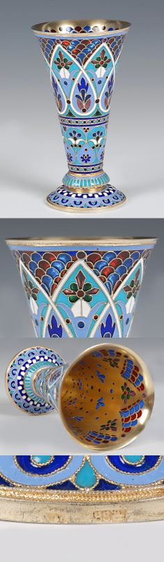 A Russian silver gilt, cloisonne and plique-a-jour enamel vase, ANtip Kuzmichev, Moscow, late 19th century. Of tapering form with spreading foot, th body decorated with scrolling floral and foliate motifs in shades of red, blue, green and purple translucent enamel