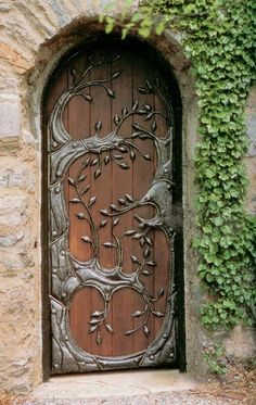 Wooden door with metal ornament via kagre.lt