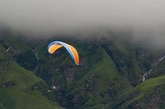 "#Adventure in the Himalayas - ParaSailing and #ParaGliding - #Parasailing, also known as parascending, or ""parakiting"" is a recreational kiting activity where a person is towed behind a vehicle [usually a boat] while attached to a specially designed canopy wing that reminds one of a parachute, known as a parasail wing. #wanderlust #fun"