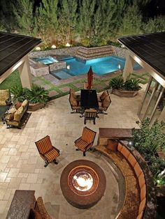 Fire Pit With Seating Near The Pool home outdoors pool backyard luxury exterior design fire pit home decorating Outdoor Rooms, Outdoor Gardens, Outdoor Living, Outdoor Patios, Outdoor Kitchens, Moderne Pools, Outside Living, Backyard Patio, Backyard Ideas