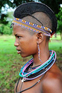 Portrait of Fulani, Peul girl with braided hair and beaded necklace, Benin | © Luca Gargano #beads #braids