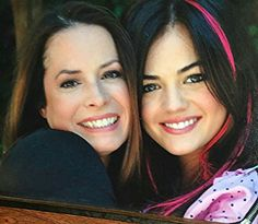Pretty Little Liars Holly Marie Combs as Ella Montgomery and Lucy Hale as Aria Montgomery behind the scenes