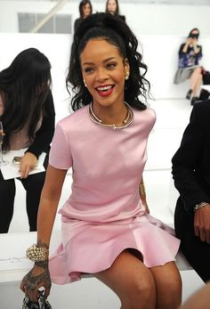 Rihanna keeps it sweet in a pink silk dress at the Dior Cruise 2015 Fashion Show