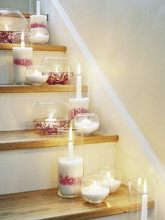 Illuminate your staircase with an assortment of candles in bowls and hurricane lamps. Use different shapes and sizes for variety. For safety, never leave lit candles unattended or use battery-operated ones.