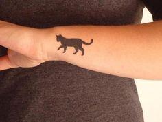 Black ink Cat Tattoo On Left Wrist