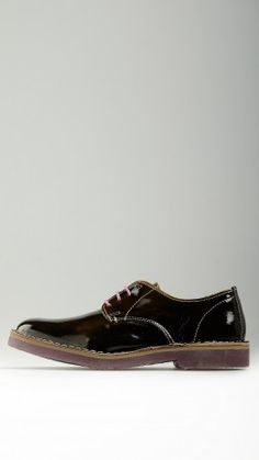 Dark green polished leather lace-ups