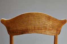 Pierced back chair designed by Peder Moos, Denmkark. 1949.  Solid hand carved walnut with box wood inlays.