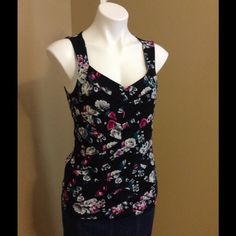 White House Black Market Top Selling a gently used top from WHBM. Floral print. I only used once. Very sexy and flattering. White House Black Market Tops Tank Tops