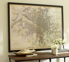 "Vintage Inspired Paris Map Framed Print from Pottery Barn. An exact reproduction of a vintage find. Professionally matted and framed. Giclee print. Frame is made of shorea wood with a black matte painted finish. Plexiglas front. 60.5""W x 46.5""H x 1.75""D. $699.00. On sale now for $594.00"